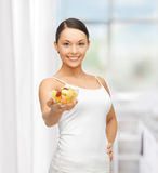 Healthy woman holding bowl with fruit salad Royalty Free Stock Photo