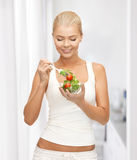 Healthy woman holding bowl with salad Stock Photo