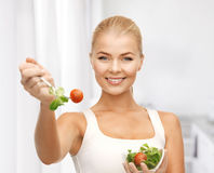 Healthy woman holding bowl with salad Stock Photography