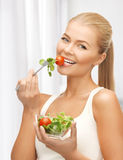 Healthy woman holding bowl with salad Royalty Free Stock Images