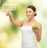 Healthy woman holding bowl with salad Stock Image
