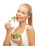 Healthy woman holding bowl with salad Royalty Free Stock Image