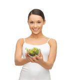 Healthy woman holding bowl with salad Royalty Free Stock Photography