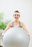 Healthy woman holding fitness ball Royalty Free Stock Photo