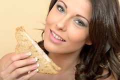 Healthy Woman Holding Half a Prawn Sandwich on Brown Bread Stock Image