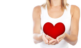 Healthy woman holding heart, selective focus. Healthy woman holding heart in hands, female body  on white background, conceptual image of health care and love Stock Image
