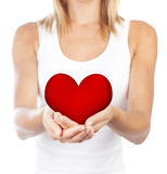 Healthy woman holding heart, selective focus. Healthy woman holding heart in hands, female body isolated on white background, conceptual image of health care and Royalty Free Stock Image