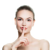 Healthy Woman Holding her Finger to her Lips Royalty Free Stock Images