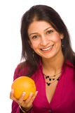 Healthy Woman Holding Orange. Healthy Indian Woman Holding an Orange against an Isolated Background Stock Photos