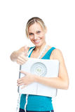 Healthy woman holding scales with thumbs up Royalty Free Stock Images