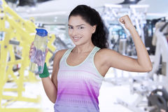 Healthy woman holds water at fitness center Stock Image