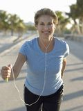 Healthy Woman Jogging Stock Photography