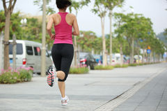 Healthy woman jogging Stock Photo