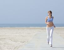 Healthy woman jogging at the beach Royalty Free Stock Images
