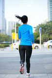 Healthy woman jogging in city Stock Photography
