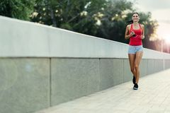 Healthy woman jogging in city stock image