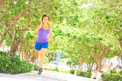 Healthy Woman Jogging In Park Royalty Free Stock Photos