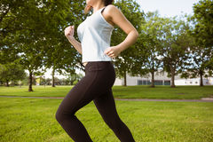 Healthy woman jogging in park Royalty Free Stock Image