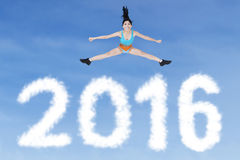 Healthy woman jumping above numbers 2016 Stock Images