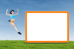 Healthy woman jumping next to copyspace Royalty Free Stock Images