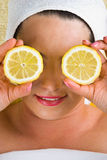 Healthy woman with lemon at spa royalty free stock images