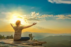 Healthy woman lifestyle balanced practicing meditate and zen energy yoga outdoors on the bridge in morning the mountain nature.