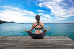 Healthy woman lifestyle balanced yoga practicing meditate and energy on the bridge in morning stock image