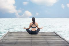 Healthy woman lifestyle meditate balanced yoga practicing and energy on the bridge stock photo