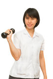 Healthy woman lifting a dumbbell Royalty Free Stock Photography