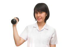 Healthy woman lifting a dumbbell Stock Photography