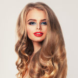 Healthy Woman with Long Blonde Hair and Makeup. Permed Hairstyle Royalty Free Stock Photos