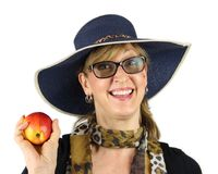 Healthy woman in a hat holding an apple stock image