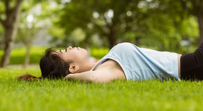 Healthy woman lying on grass in park Royalty Free Stock Photo