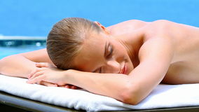Healthy woman lying on spa bed at tropical outdoors Stock Photos