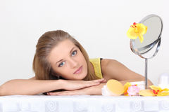 Healthy woman with make up accessories and mirror Stock Photos