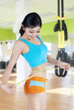 Healthy woman measuring her waistline Stock Photo
