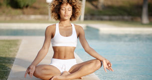 Healthy Woman Meditating Near The Pool Royalty Free Stock Photos