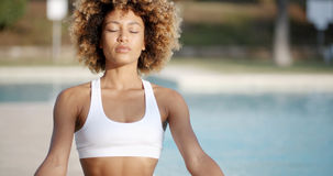 Healthy Woman Meditating Near The Pool Stock Images