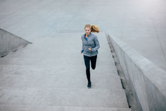 Healthy woman on morning run Stock Photo