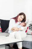 Healthy Woman and New Born Boy Relax in White Bedroom or Living Royalty Free Stock Image