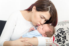 Healthy Woman and New Born Boy Relax in White Bedroom or Living Royalty Free Stock Images