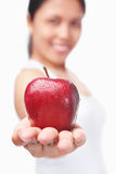 Healthy woman offering red apple Stock Photos