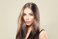 Healthy Woman with Perfect Skin and Long Brown Hair Stock Photos