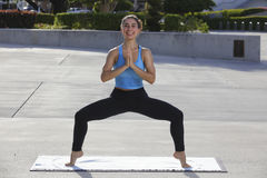 Healthy woman performing yoga Stock Images