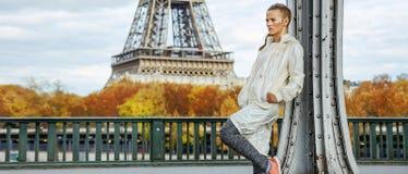 Healthy woman on Pont de Bir-Hakeim bridge looking into distance Stock Photos