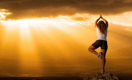 Healthy woman  practice yoga at sunset Stock Photography