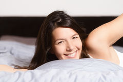 Healthy woman refreshed after a good nights sleep Stock Photos