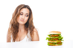 Healthy woman rejecting junk food isolated. Picture of healthy woman rejecting junk food isolated over white background Stock Photography