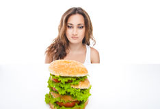 Healthy woman rejecting junk food isolated. Picture of healthy woman rejecting junk food isolated over white background Stock Images
