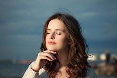 Healthy Woman Relaxing Outdoor. Young Beautiful Model. On Blue Sea and Sky Background Stock Photography